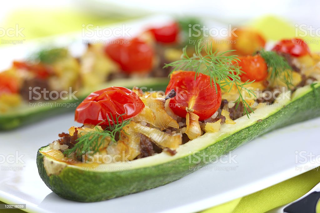 Zucchini stuffed with meat, onions and vegetables stock photo