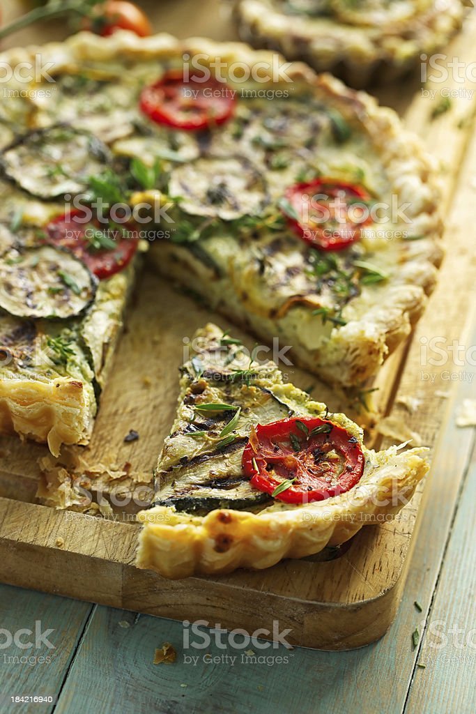Zucchini tart with tomato and herbs stock photo