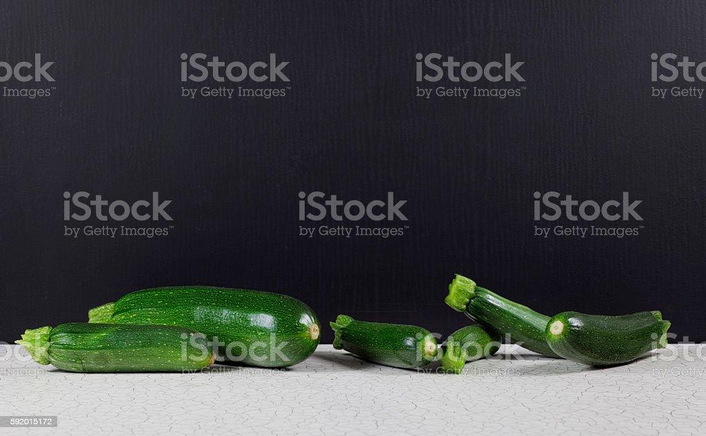 Zucchini vor Tafelhintergrund stock photo