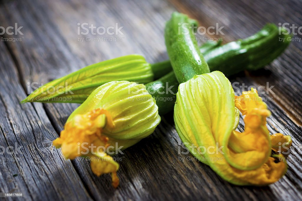Zucchini with flowers stock photo