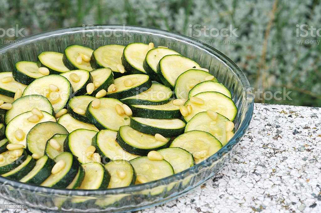 zucchini with pine nuts in outdoor setting royalty-free stock photo