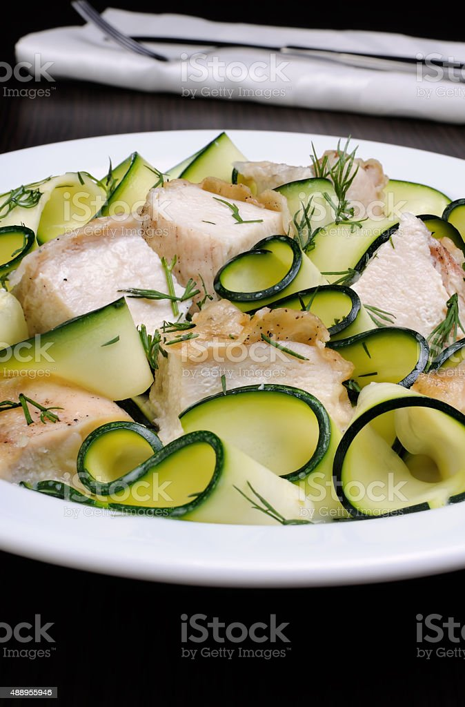 zucchini with slices of chicken stock photo