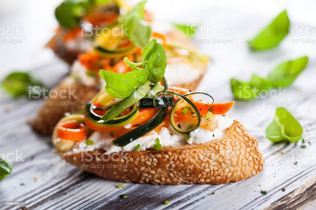 Zucchini,carrot and cheese bruschetta stock photo