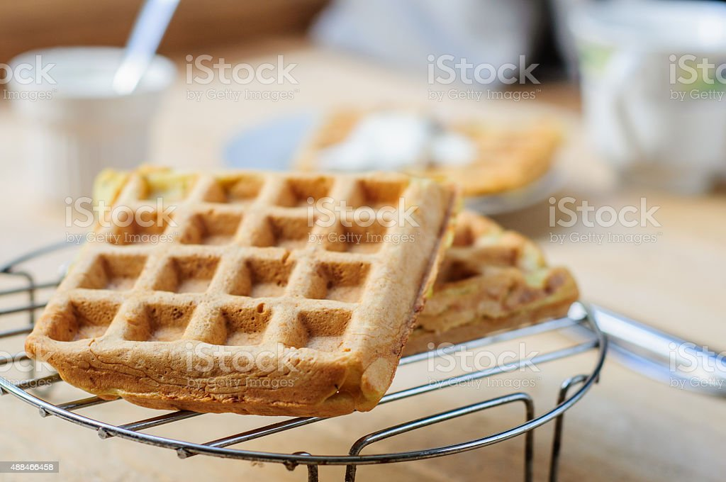 Zuccini hash brown waffles with sour cream stock photo