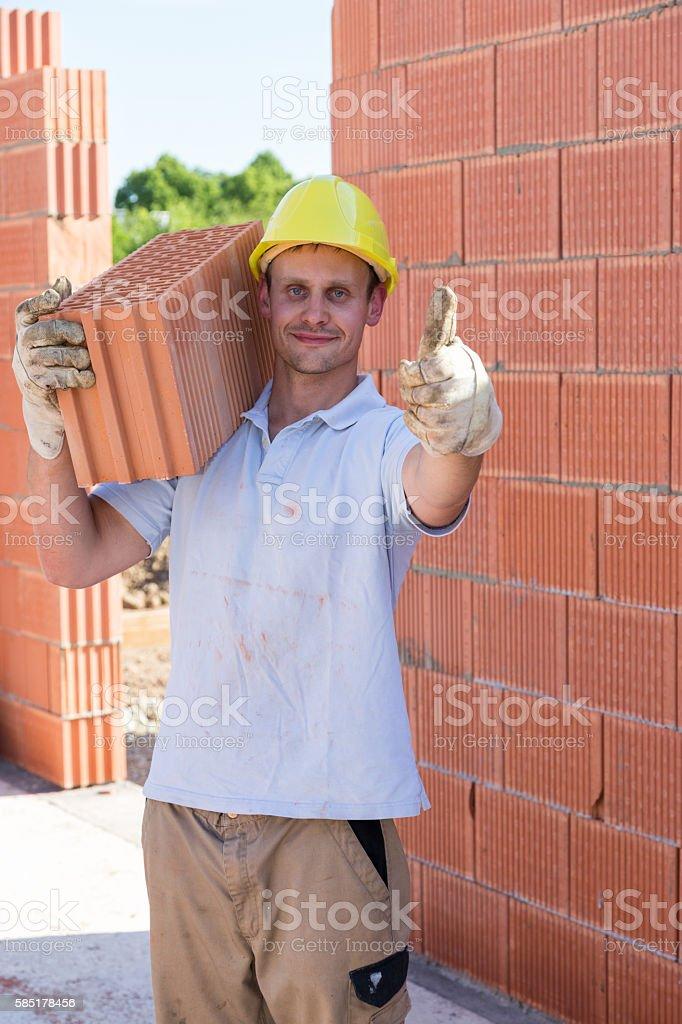 zufriedener Bauarbeiter stock photo
