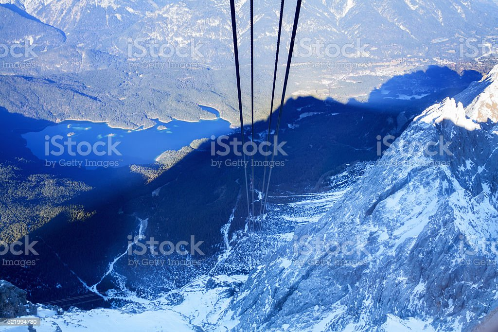 Zugspitze, cables and lake Eibsee stock photo