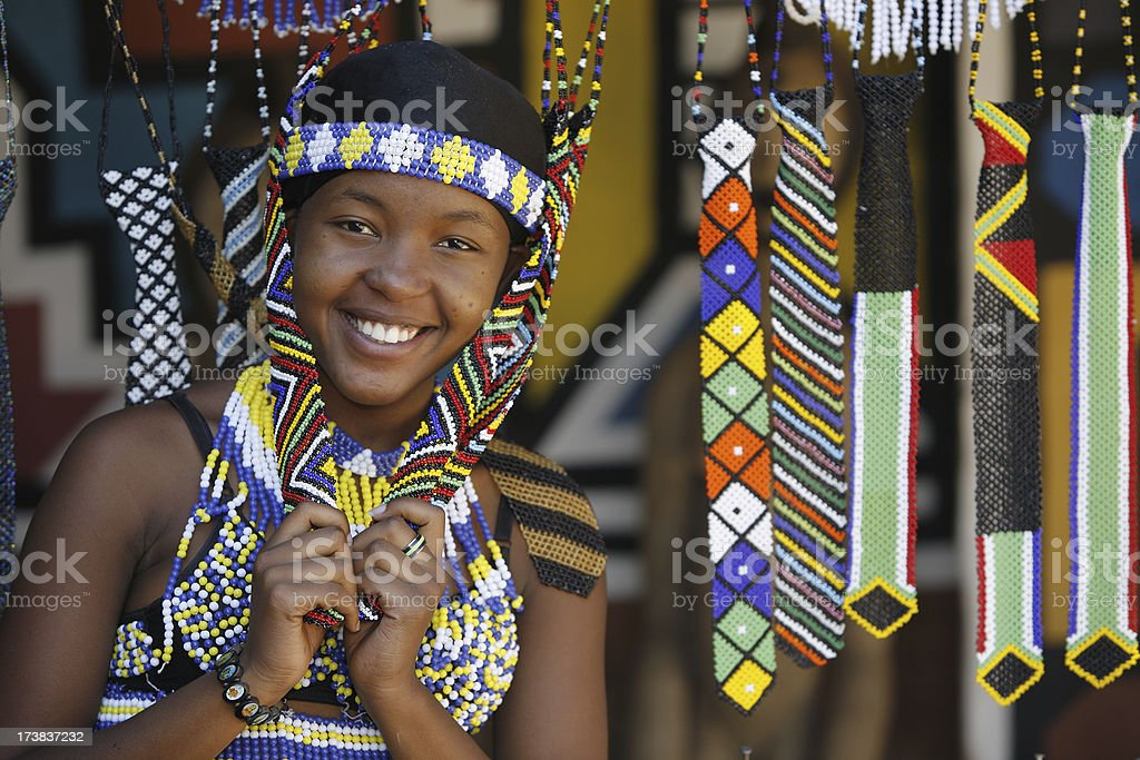 Zulu girl with beaded souvenirs stock photo