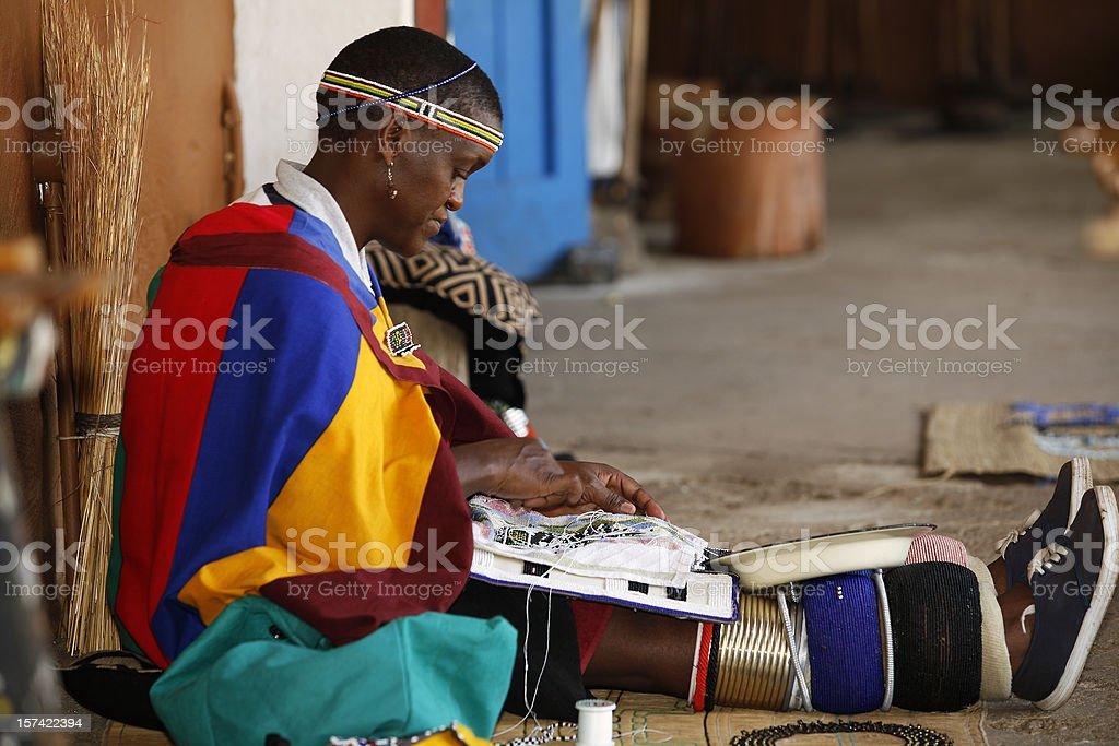 Zulu woman beading stock photo