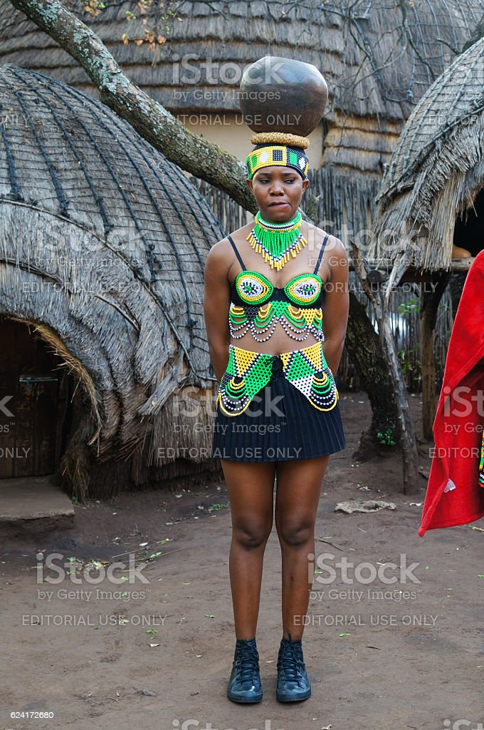 Zulu woman puts the pot on her head,South Africa. stock photo
