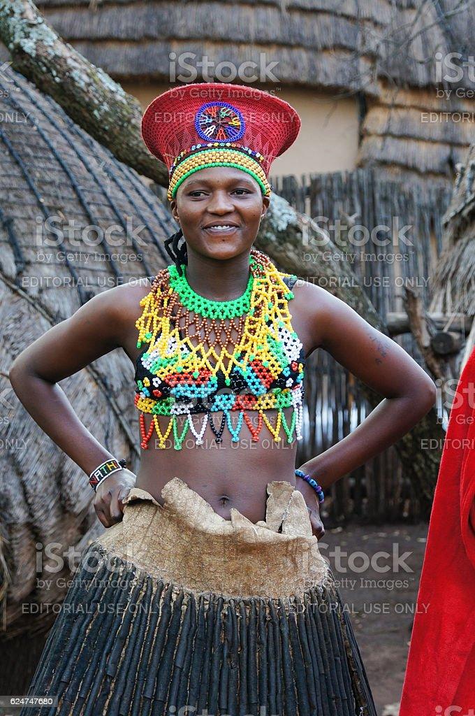 Zulu woman wearing handmade clothing at Lesedi Cultural Village. stock photo