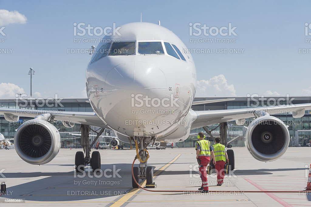 Zurich airport ground crew around parked Airbus A320 aircraft stock photo
