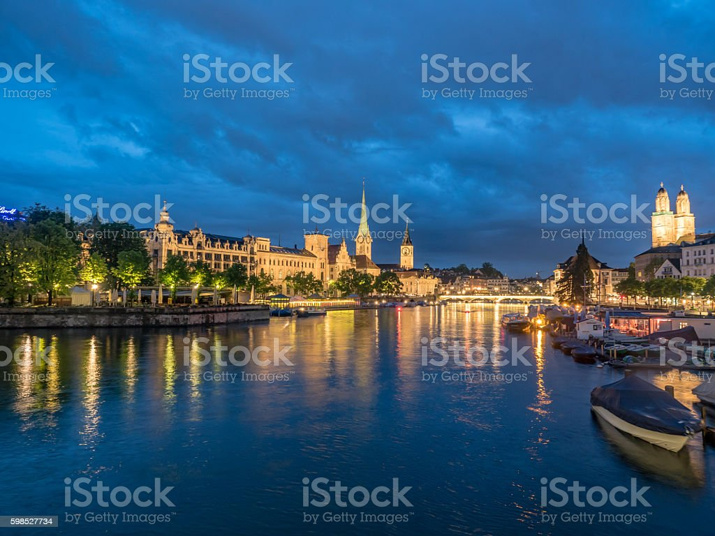 Zurich and Limmat river after dusk stock photo