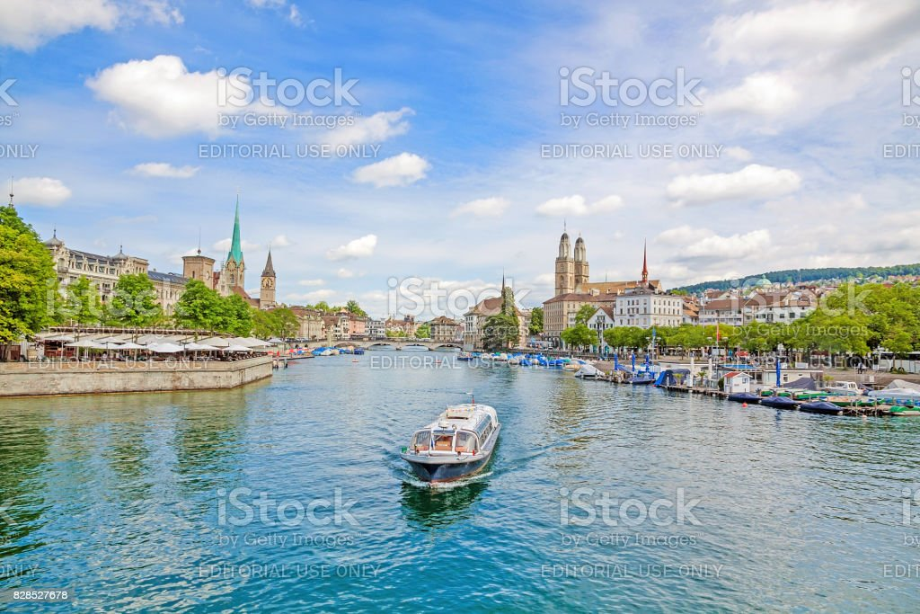 Zurich with Grossmunster, Fraumunster and Sankt Peter, cruise vessel on Limmat stock photo