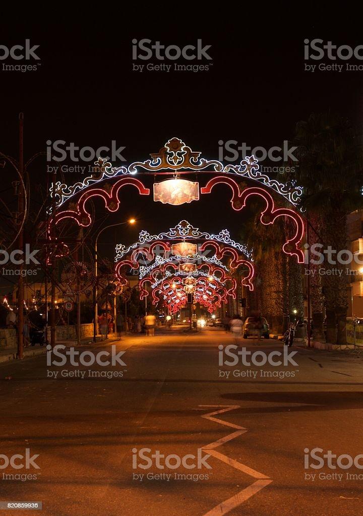Zurrieq, MALTA - 2 Sep,2016: Feast of Santa Catharina at night with celebrating maltese people. People of Malta are celebrating the Feast of Santa Catharina in Zurrieq village, Malta,editorial stock photo