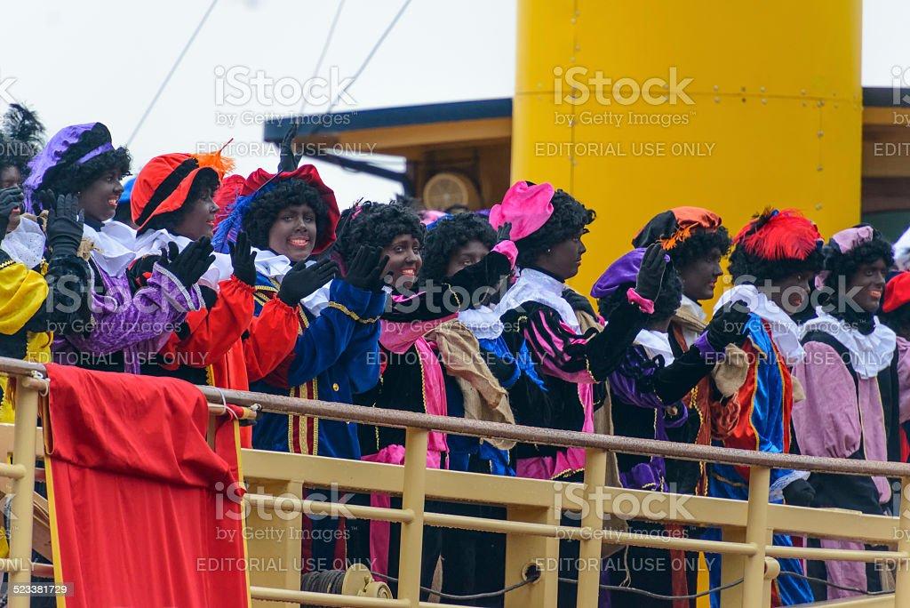 Zwarte Pieten (black pete) on deck of the steamboat stock photo