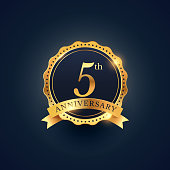 5th anniversary celebration badge label in golden color