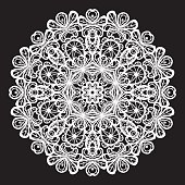 Abstract white circular lace pattern on black background