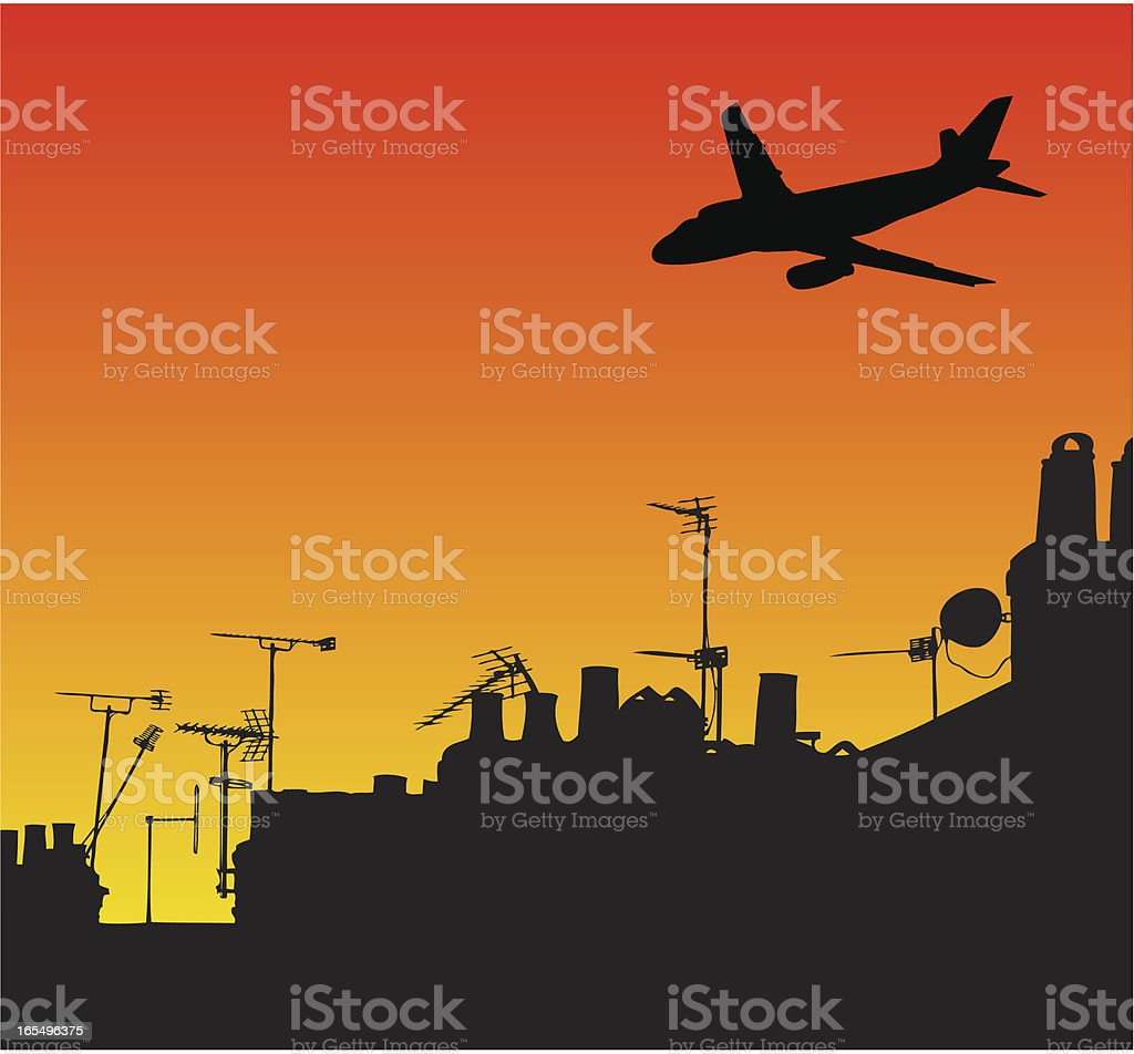 Airplane over silhouetted rooftops royalty-free stock vector art