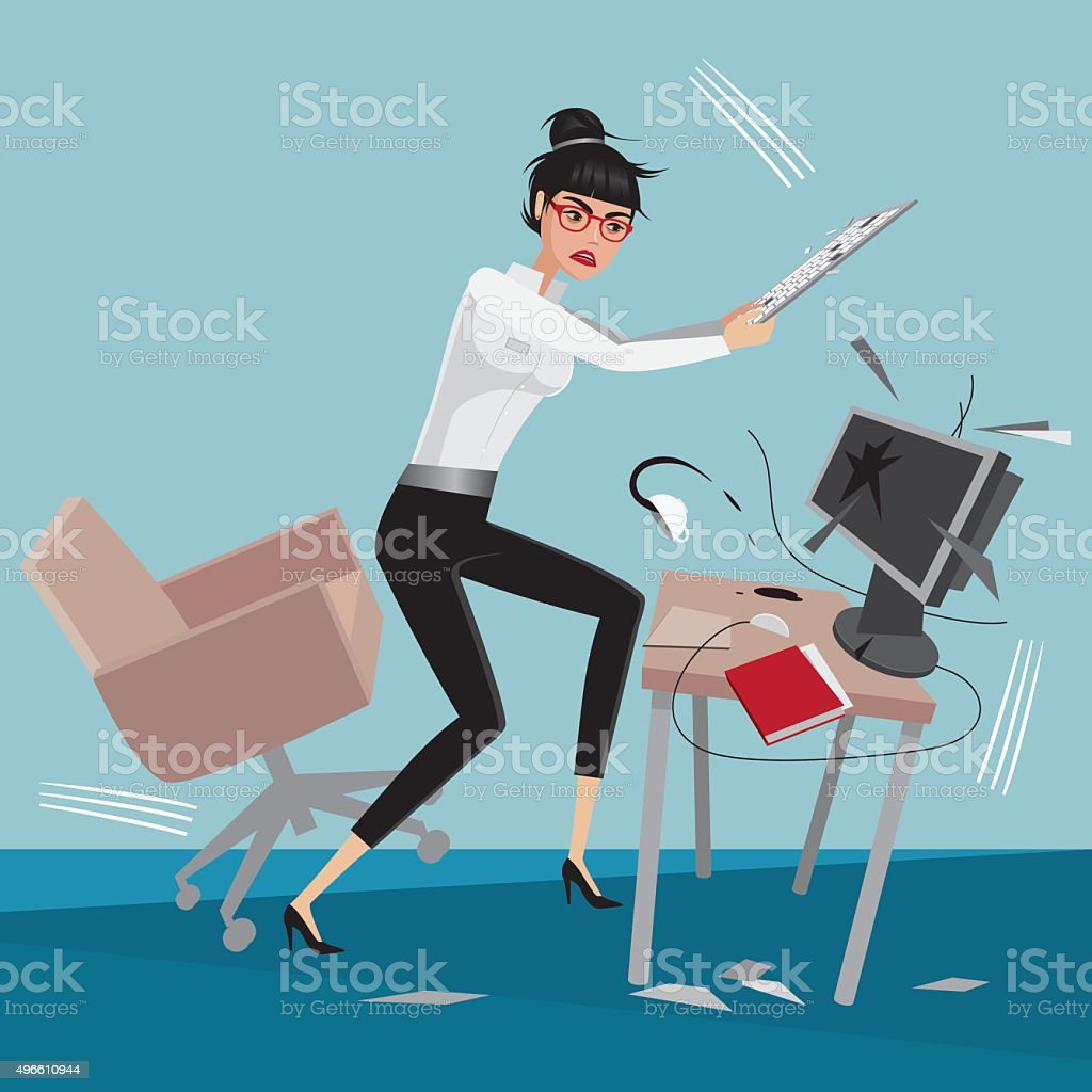 Angry business woman breaks a computer at workplace in office