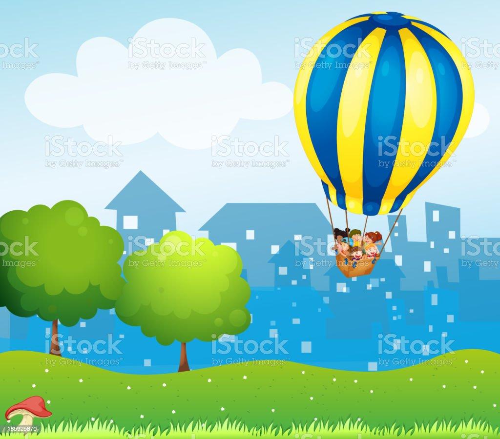 big hot air balloon above the hill royalty-free stock vector art
