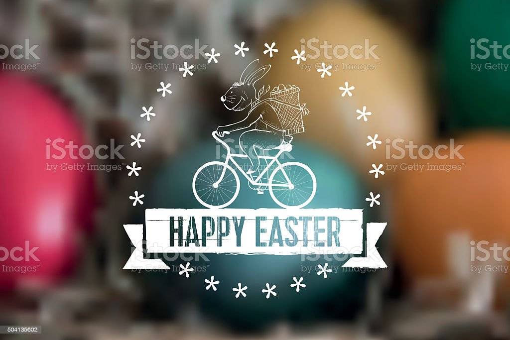 biking line art easter bunny label  on blurred easter nest stock photo