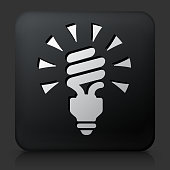 Black Square Button with Spiral Energy Saving Light Bulb