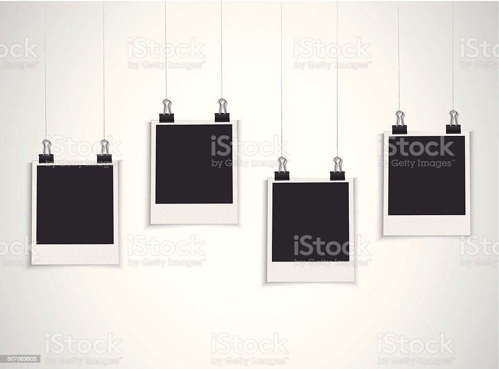 Blank photo frame hanging on a line vector art illustration