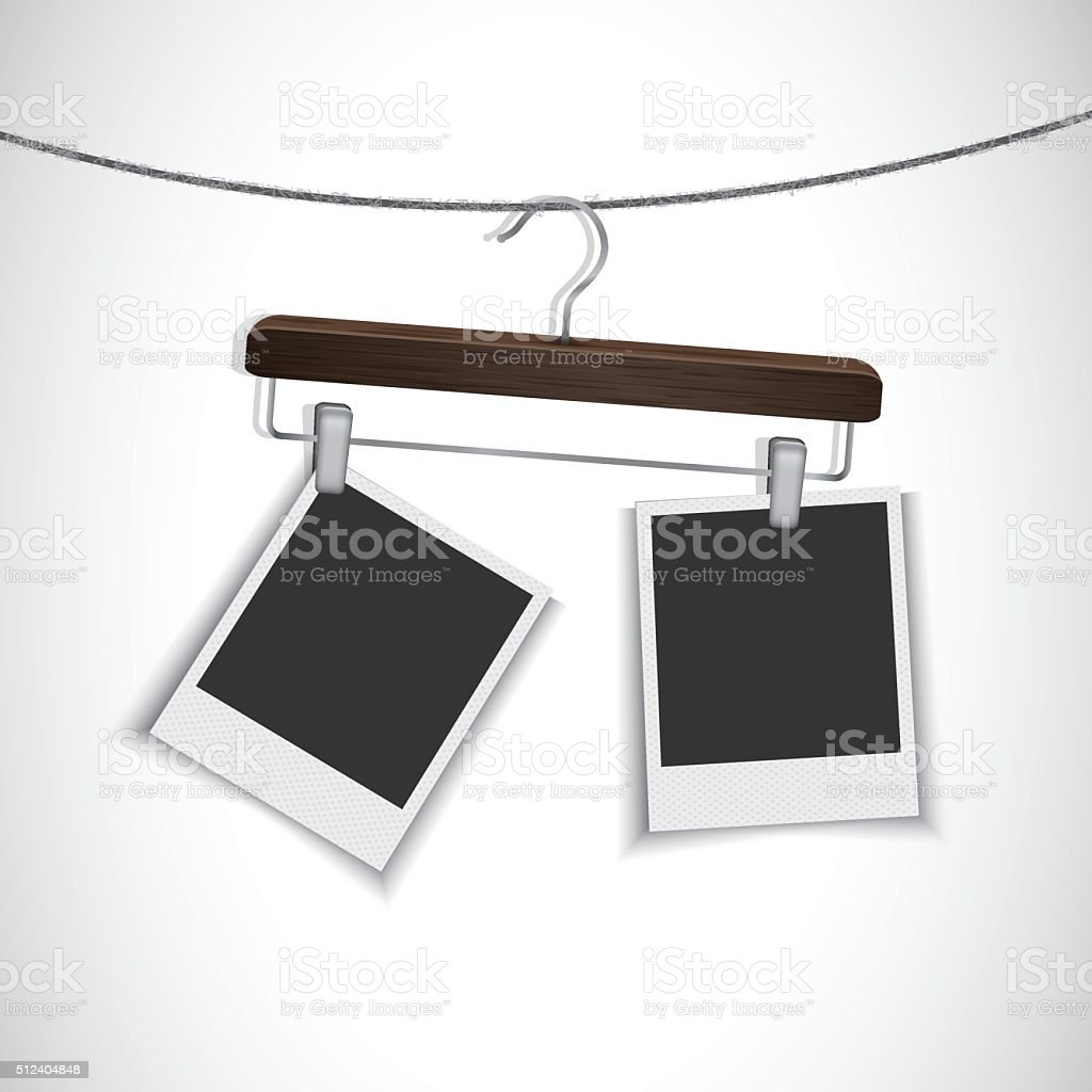 Blank photo frame hanging on a rope with clothes hanger vector art illustration