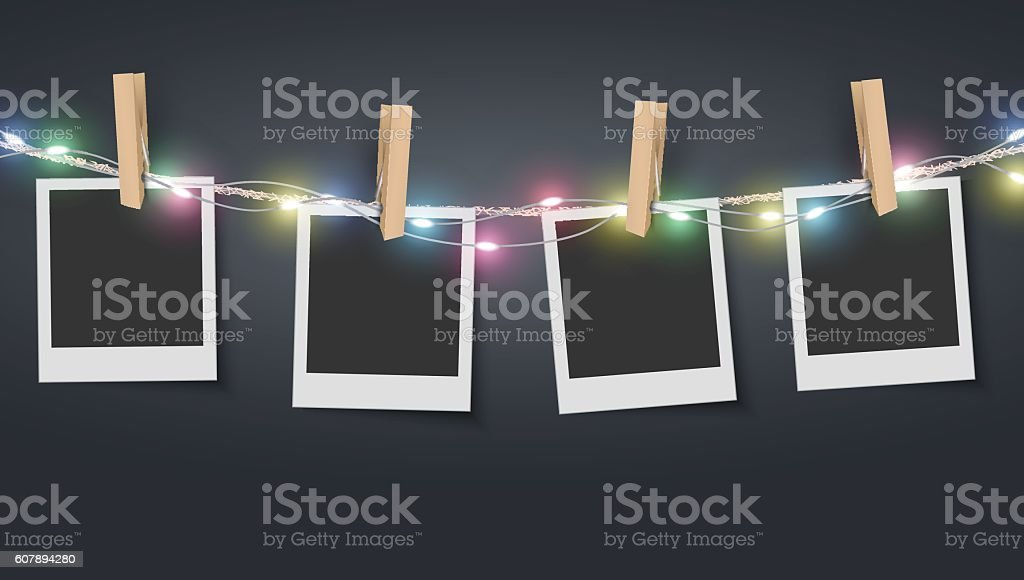 Blank photo frame hanging on rope with colorful fairy lights vector art illustration
