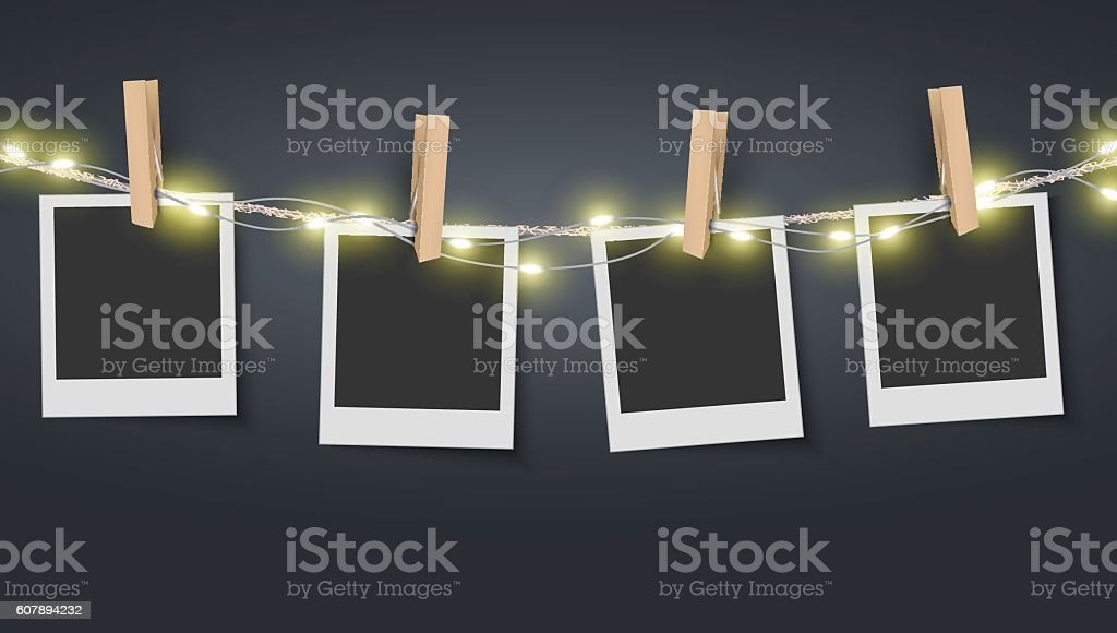 Blank photo frame hanging on rope with fairy lights vector art illustration