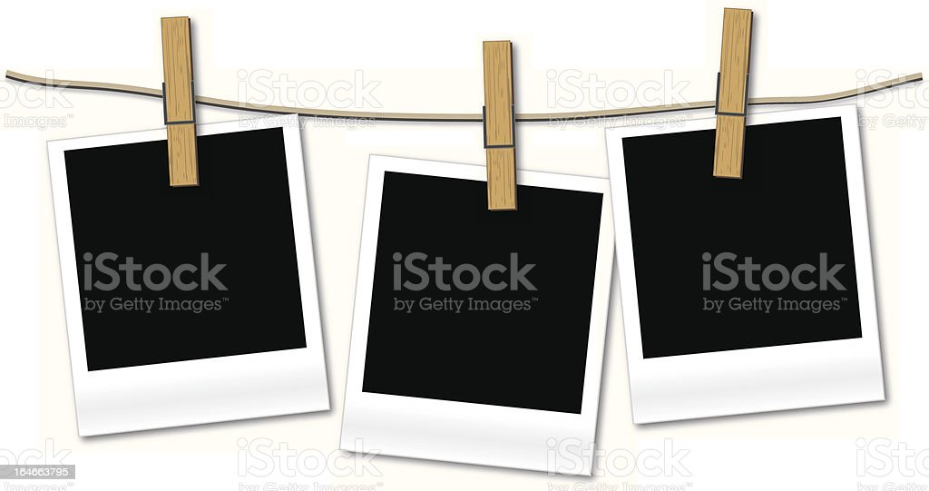 Blank photos hanging on rope vector art illustration