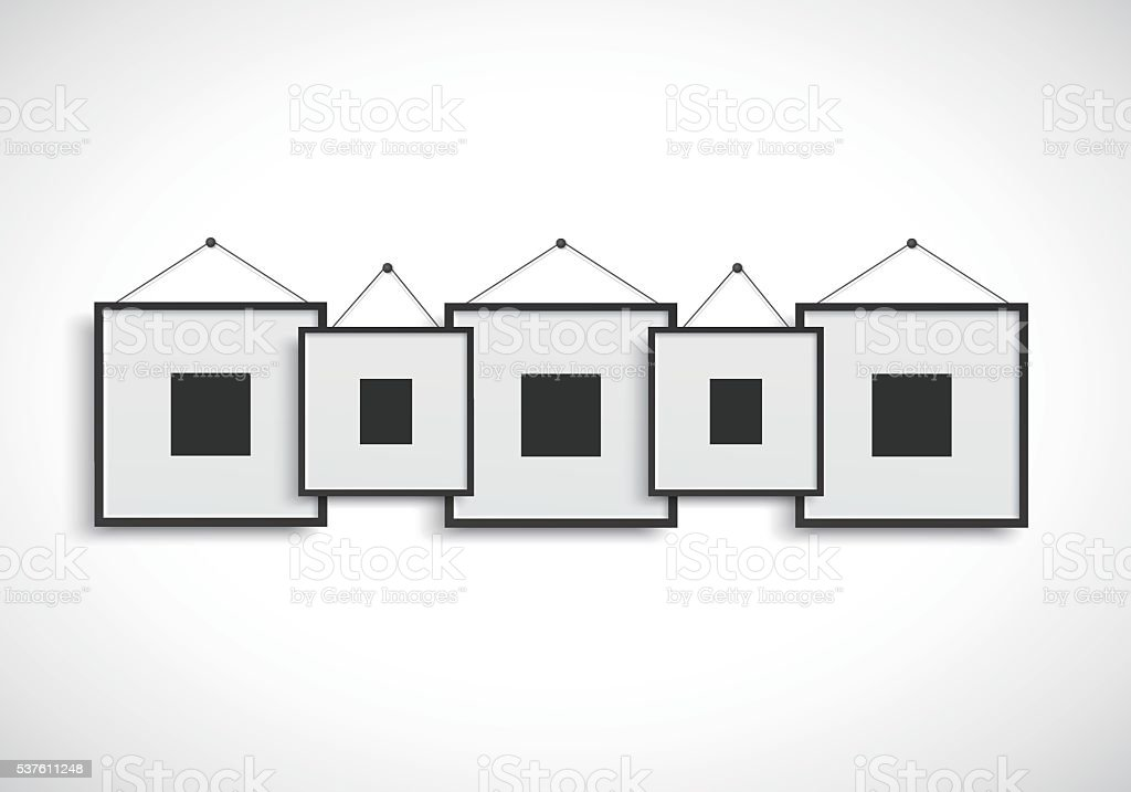 Blank picture frame hanging on wall vector art illustration