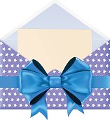 Blue envelope with star pattern, decorated with blue ribbon bow
