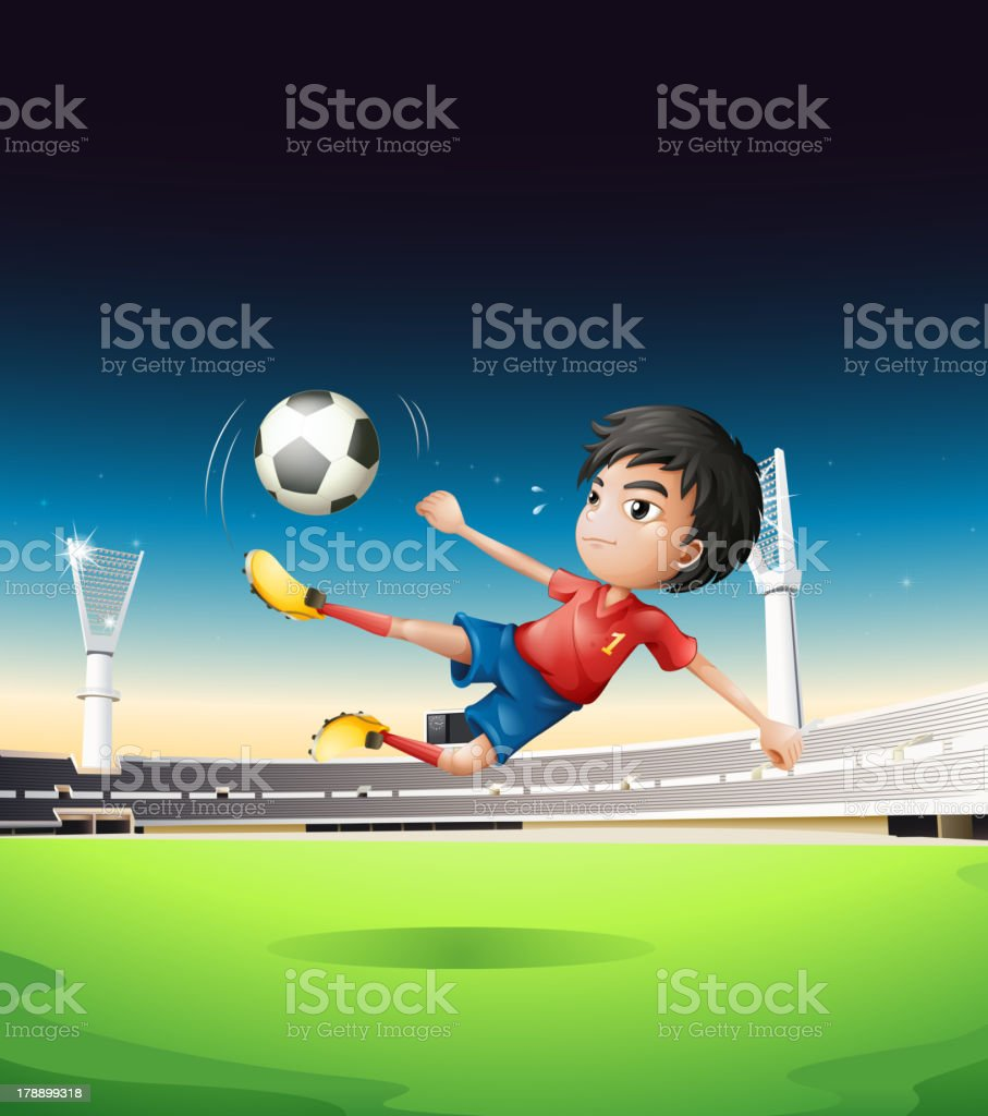 boy in a red uniform at the soccer field royalty-free stock vector art