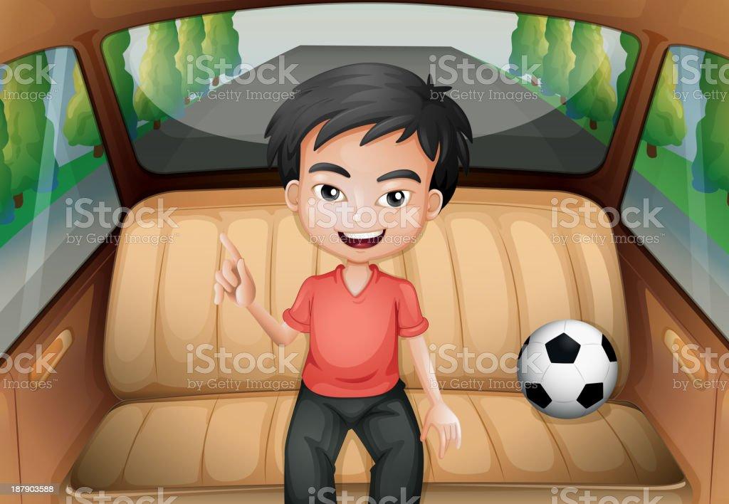 boy inside the car with a soccer ball royalty-free stock vector art