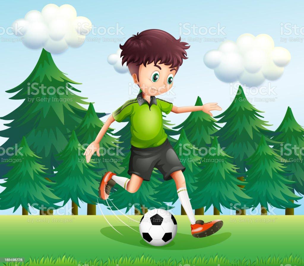 boy kicking a soccer ball near the pine trees royalty-free stock vector art