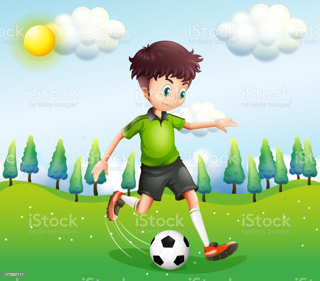 Boy playing football in the hill royalty-free stock vector art