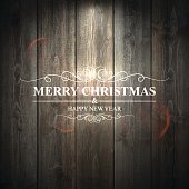 Bright Merry Christmas lettering on lit wooden Background