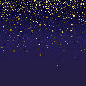 Brilliant, golden and sparkling dust particles, shape of heart, stars