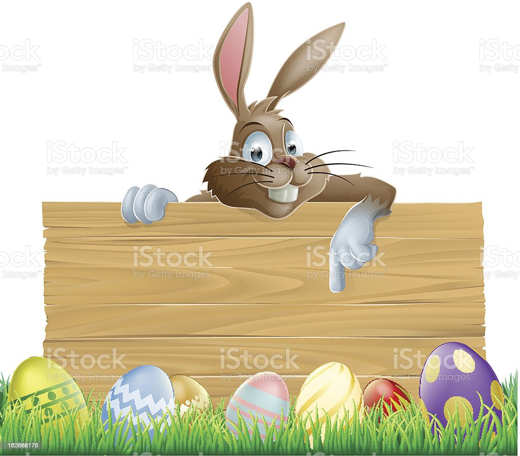 Bunny character pointing and Easter eggs royalty-free stock vector art