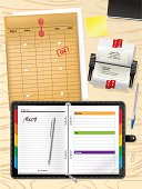 Business executive with planner rolodex on wood desktop