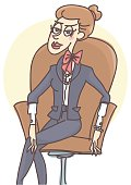 Business woman sitting in leather armchair