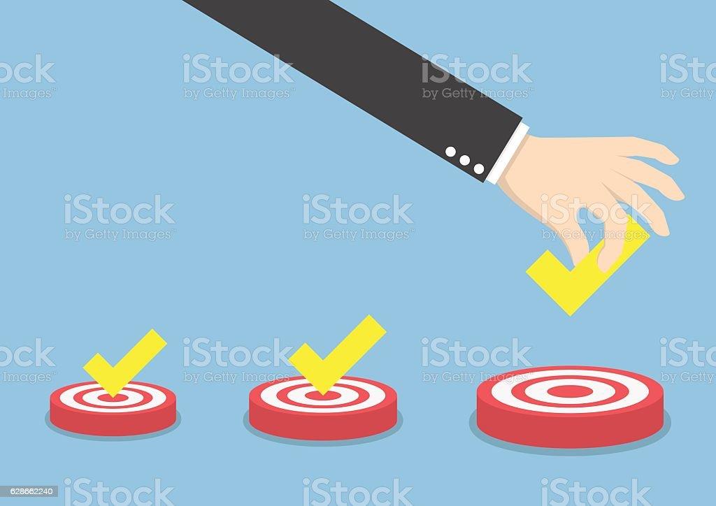 Businessman hand put the check mark on targets vector art illustration
