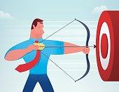 businessman hitting target