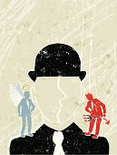 Businessman with Angel and Devil on his Shoulders