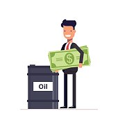 Businessman with money manager or stands near the barrels of