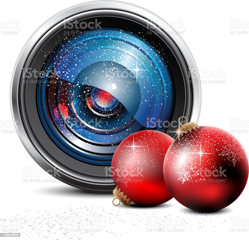 Camera Lens and christmas baubles royalty-free stock vector art
