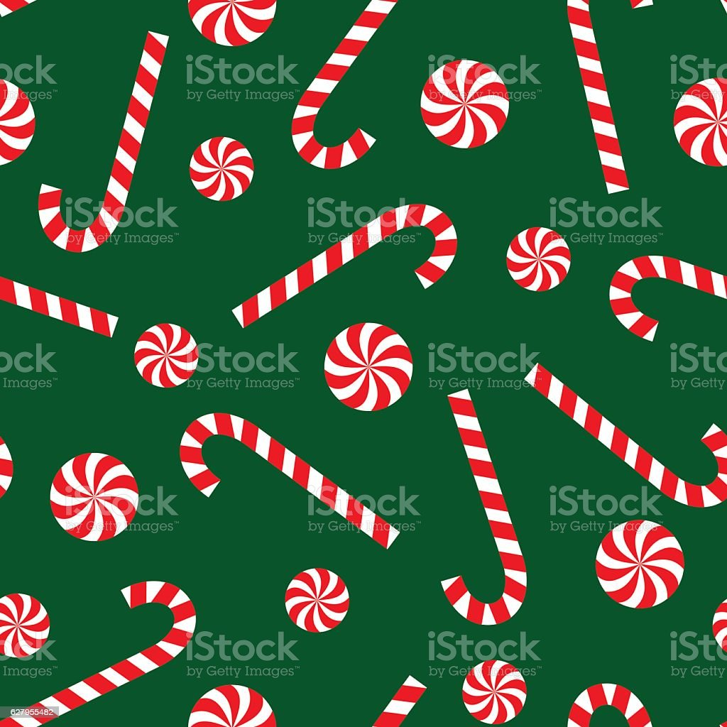 Candy cane and lollipop seamless christmas pattern on green background. vector art illustration
