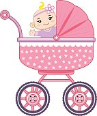 Cheerful baby girl in her baby carriage
