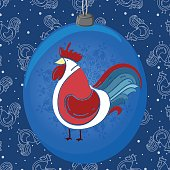 Christmas ball with the rooster and snowflakes.
